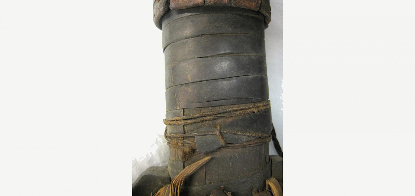 Detail of original repair on quiver (1910.68.12)