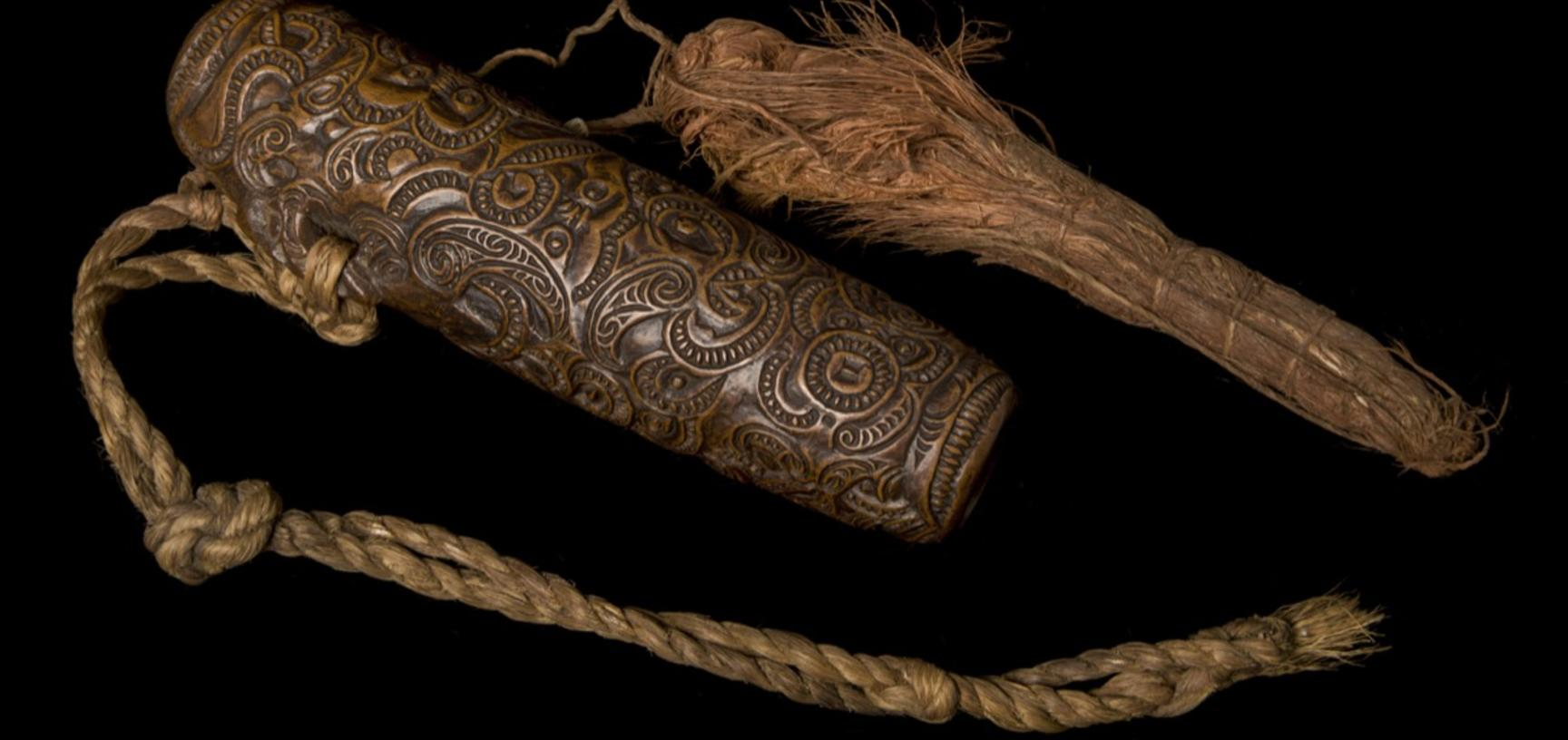 Wooden Kōauau or small flute with three finger holes.