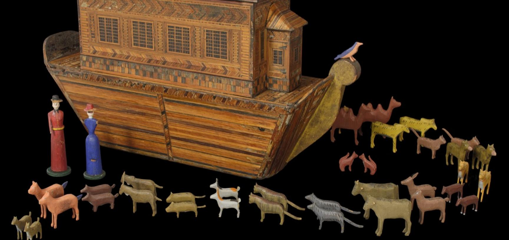 Wooden boat with animals in pairs and two human figurines