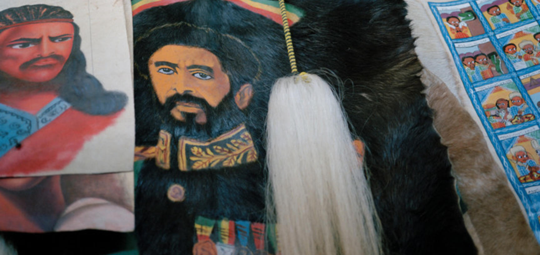 Items for sale in an Addis Ababa shop, including one featuring the image of Haile Selassie with his military decorations. Addis Ababa, Ethiopia. Photograph by Peter Marlow. 2000.
