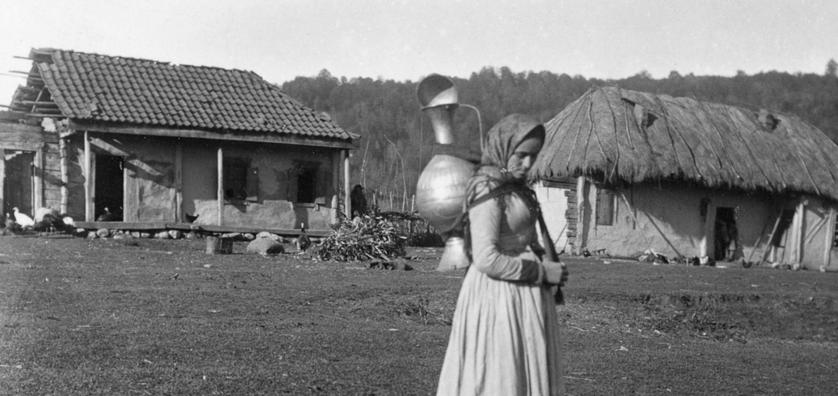 The niece of Hadji Maali, an Ingush leader, carrying a water jar. Photograph by John Baddeley. Muzhichi, Republic of Ingushetia, Russia. 8 October 1901.