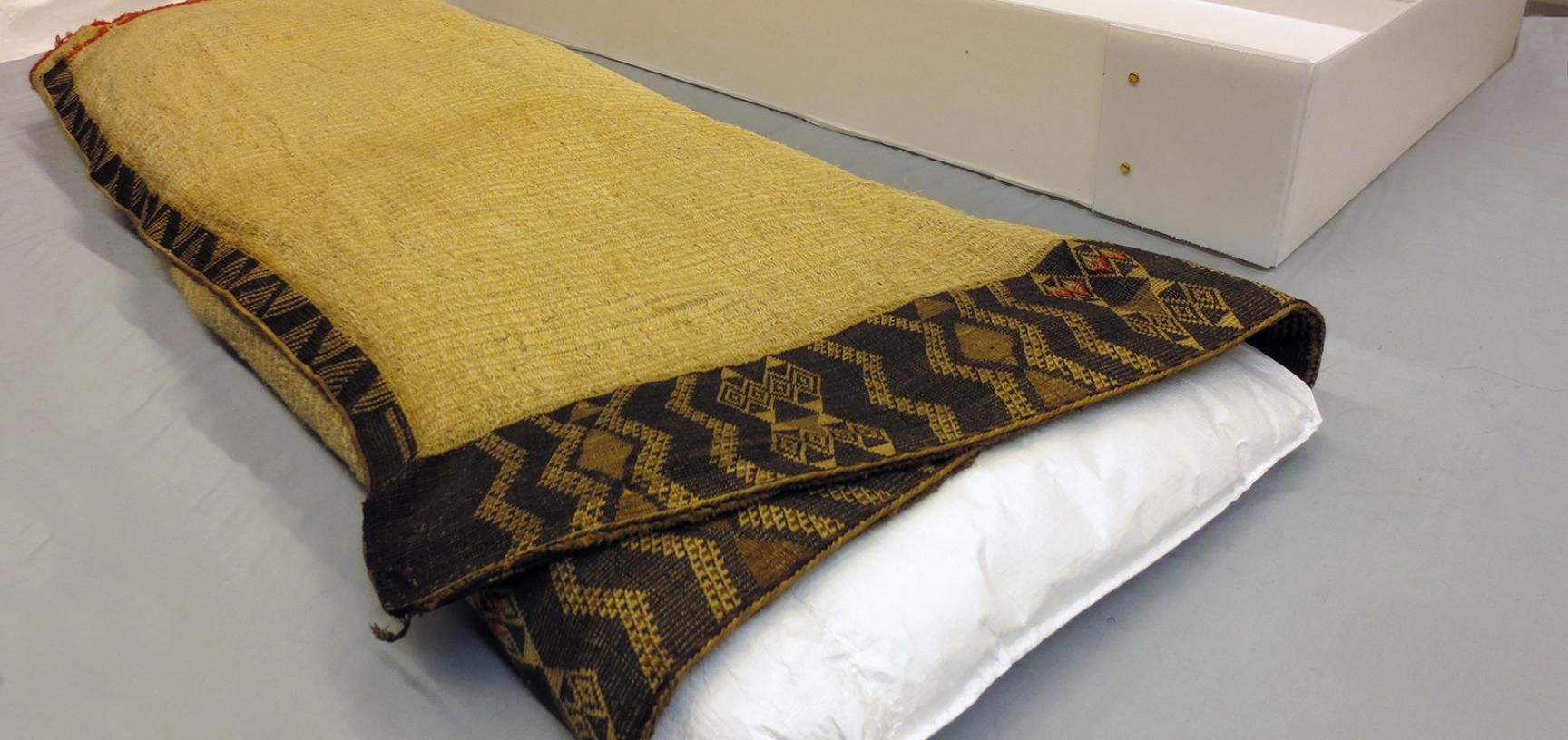 Cloak (1923.87.162) folded for storage