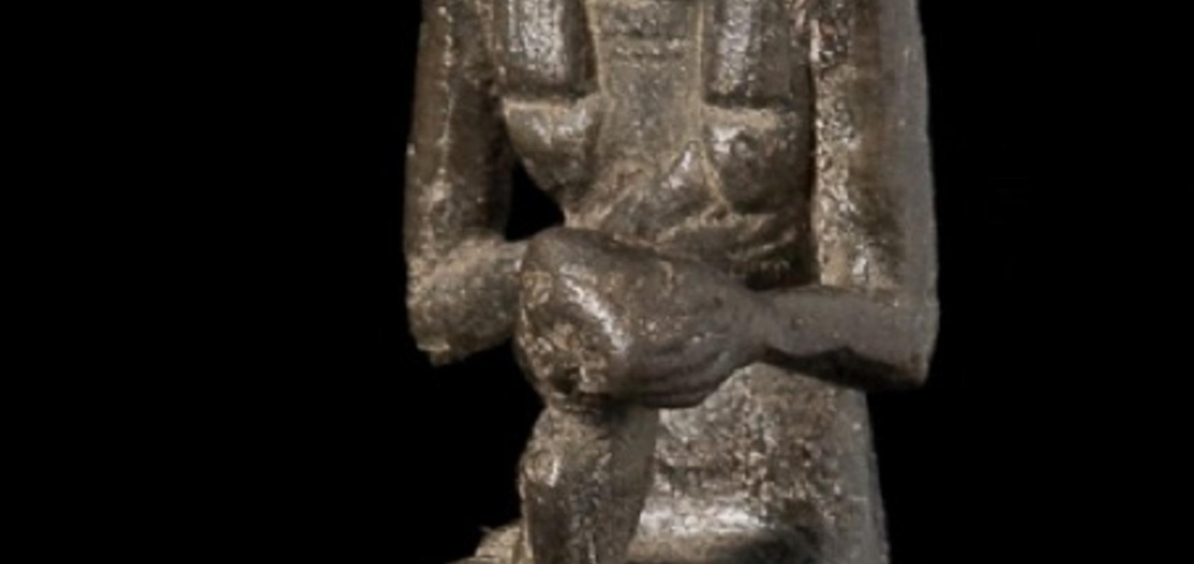 Small seated figure.