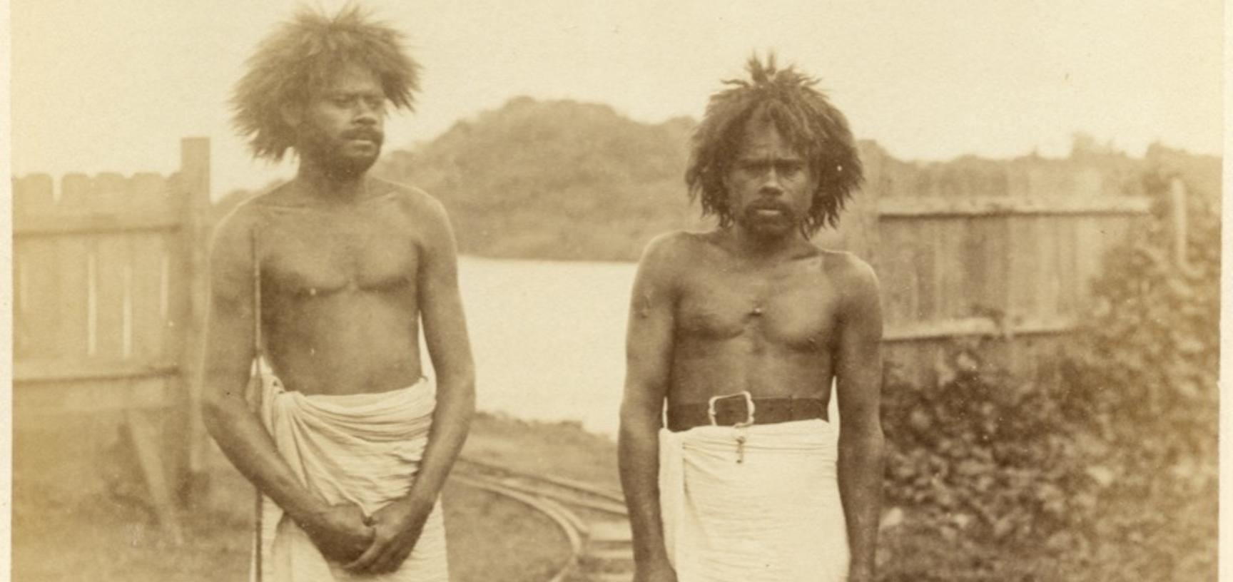 Portrait of two Fijian men, labourers, pictured beside the Rewa River. Photograph by Alfred Burton for the Burton Brothers studio (Dunedin). Viti Levu, Fiji. June 1884. (Copyright Pitt Rivers Museum, University of Oxford. Accession Number: 1998.238.4)