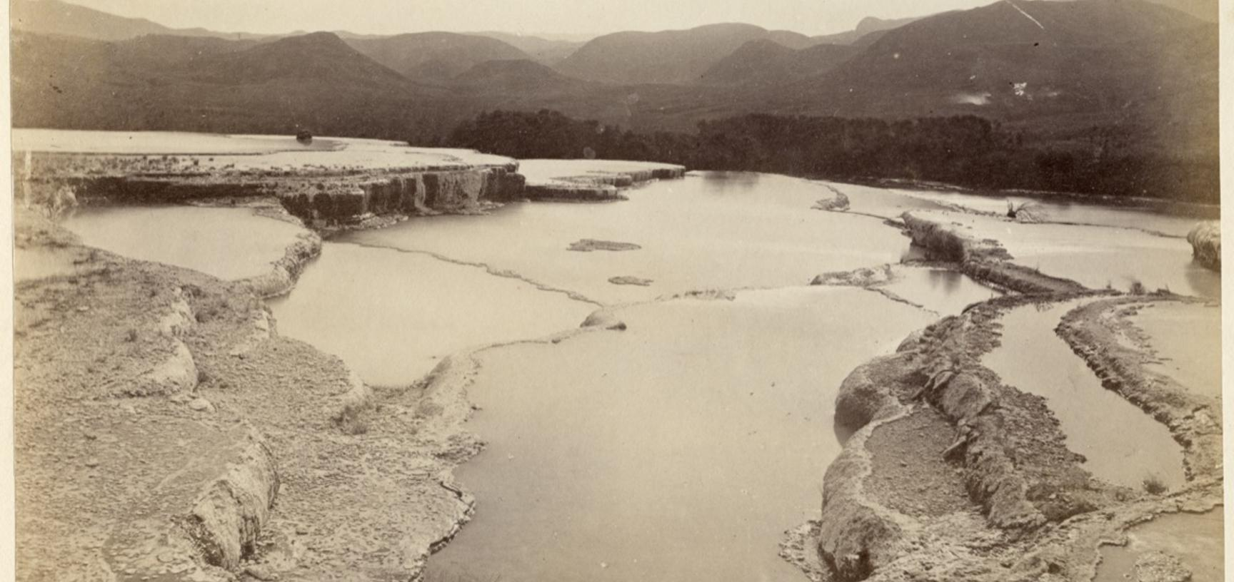 View of the geological structure known as the 'White Terraces', a popular tourist attraction located at the edge of Lake Rotomahana, near Rotorua. Photograph by Alfred Burton for the Burton Brothers studio (Dunedin). Lake Rotomahana, North Island, New Zea