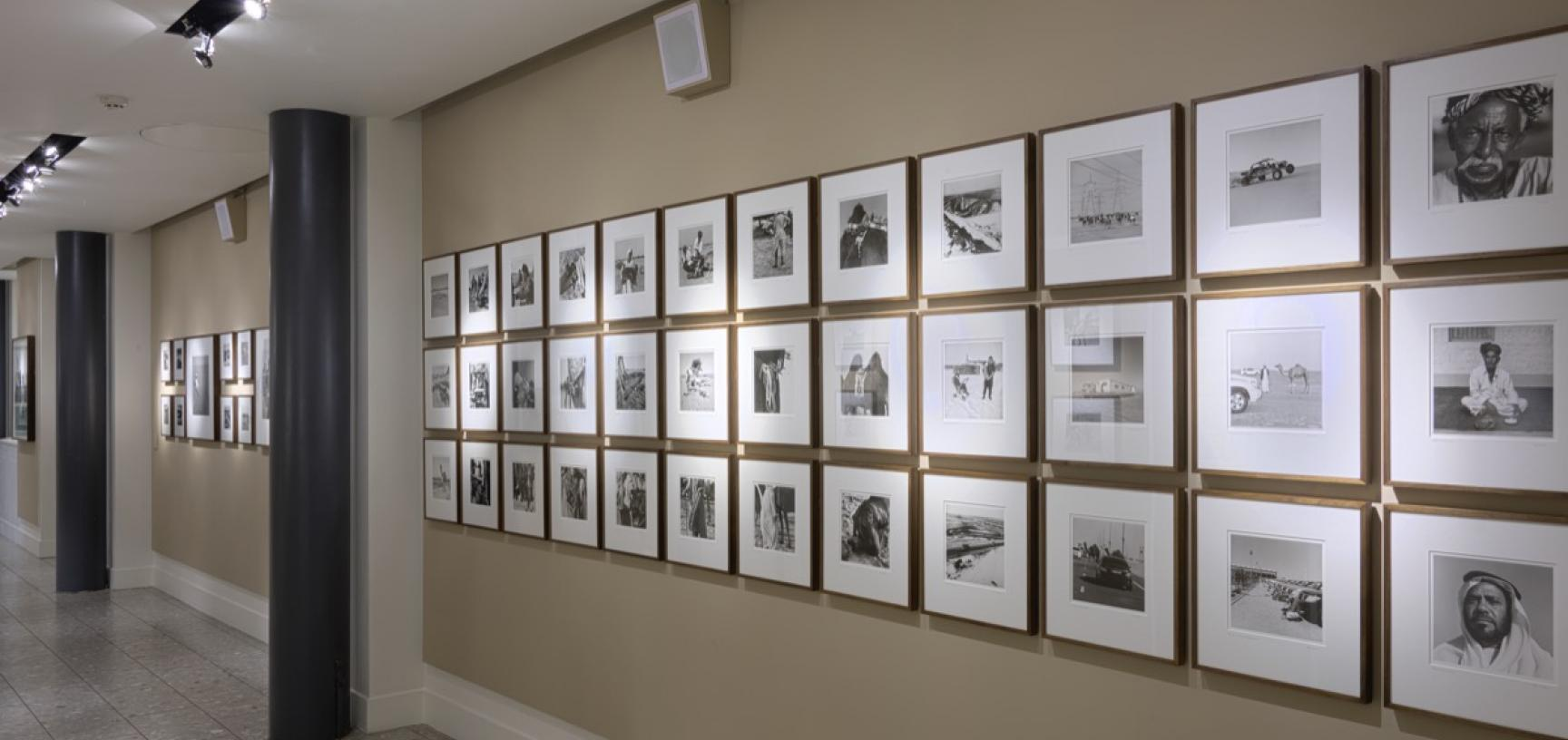 Display of black and white photographs on a wall