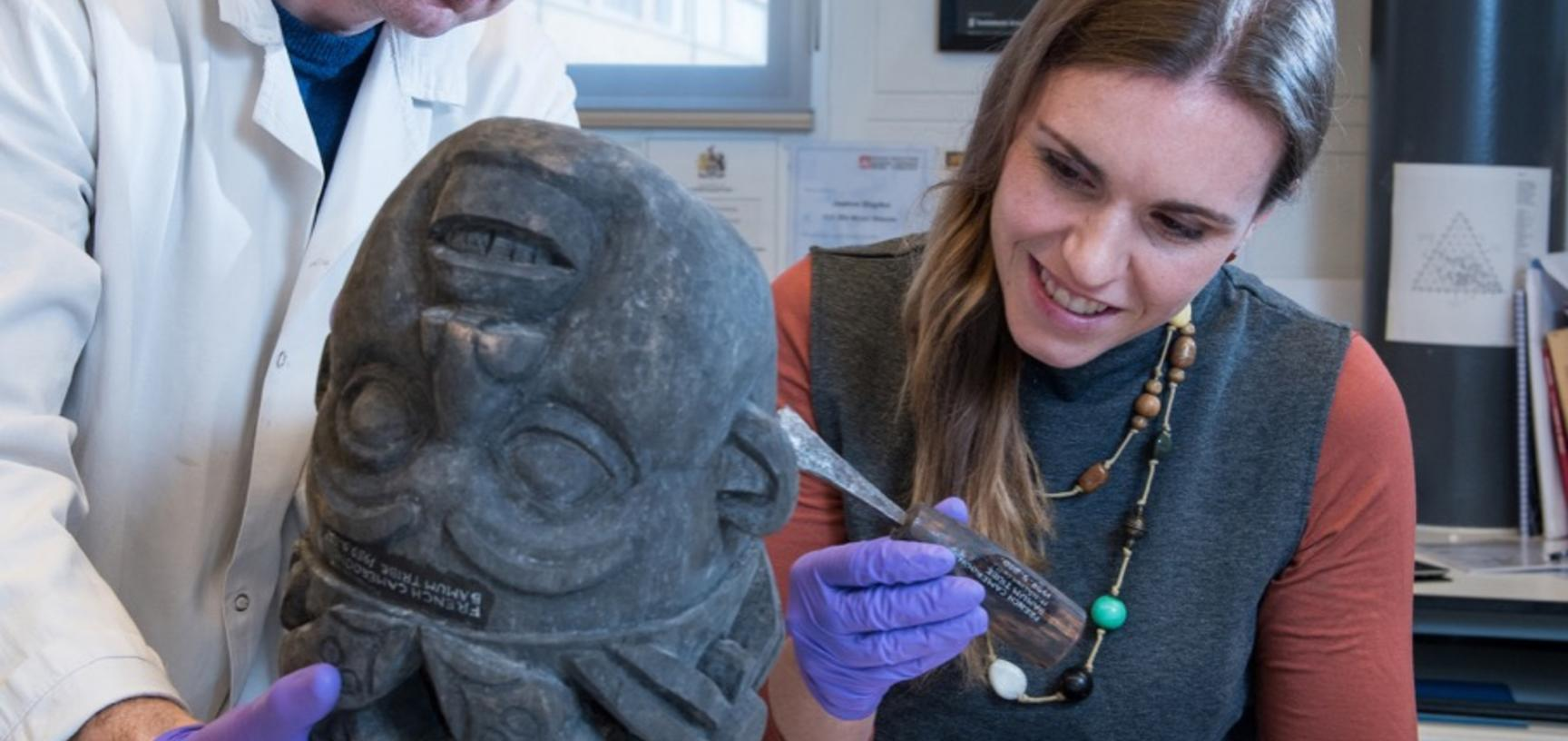 Creating new displays. We wanted to show the process of making, from raw materials to tools to finished products. Here, staff pair a wooden mask from Cameroon with a chisel collected with it and possibly used in its making.