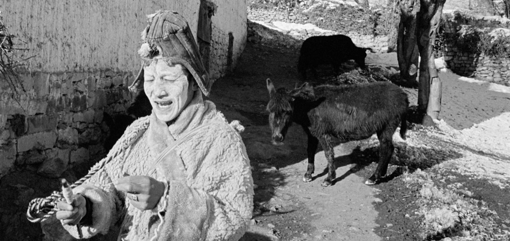 Pema Namgyal in the role of Lugsi the shepherd during a stone breaking ceremony. Photograph by Patrick Sutherland. Lara, Spiti, Himachal Pradesh, India. 2004.
