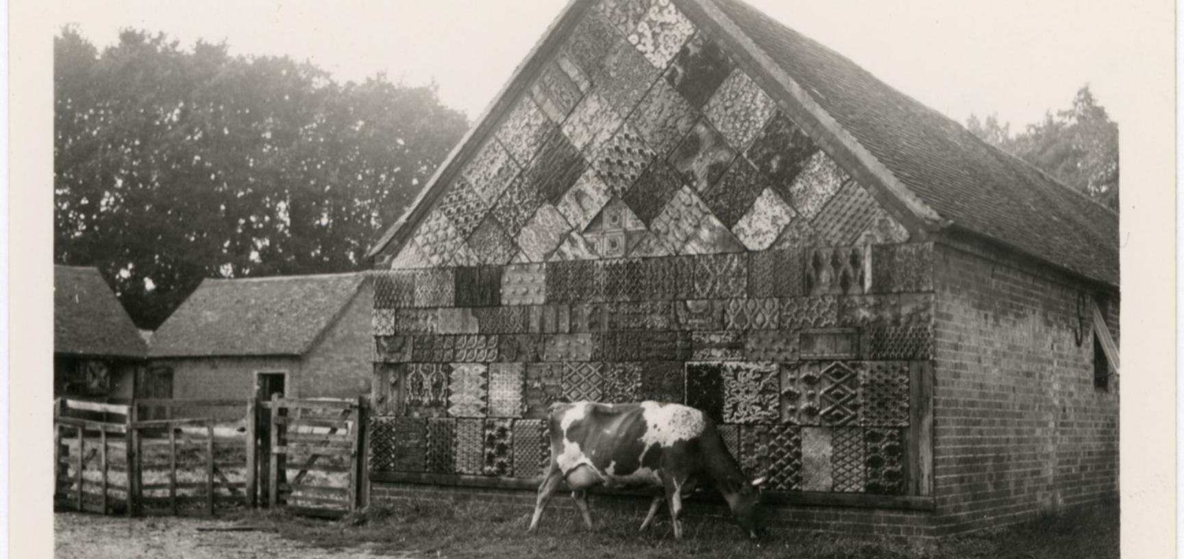 'Harpsden, Oxon. Barn decorated with old printing plates' (typed caption). Photograph by Ellen Ettlinger. Harpsden, Oxfordshire, England. Undated.