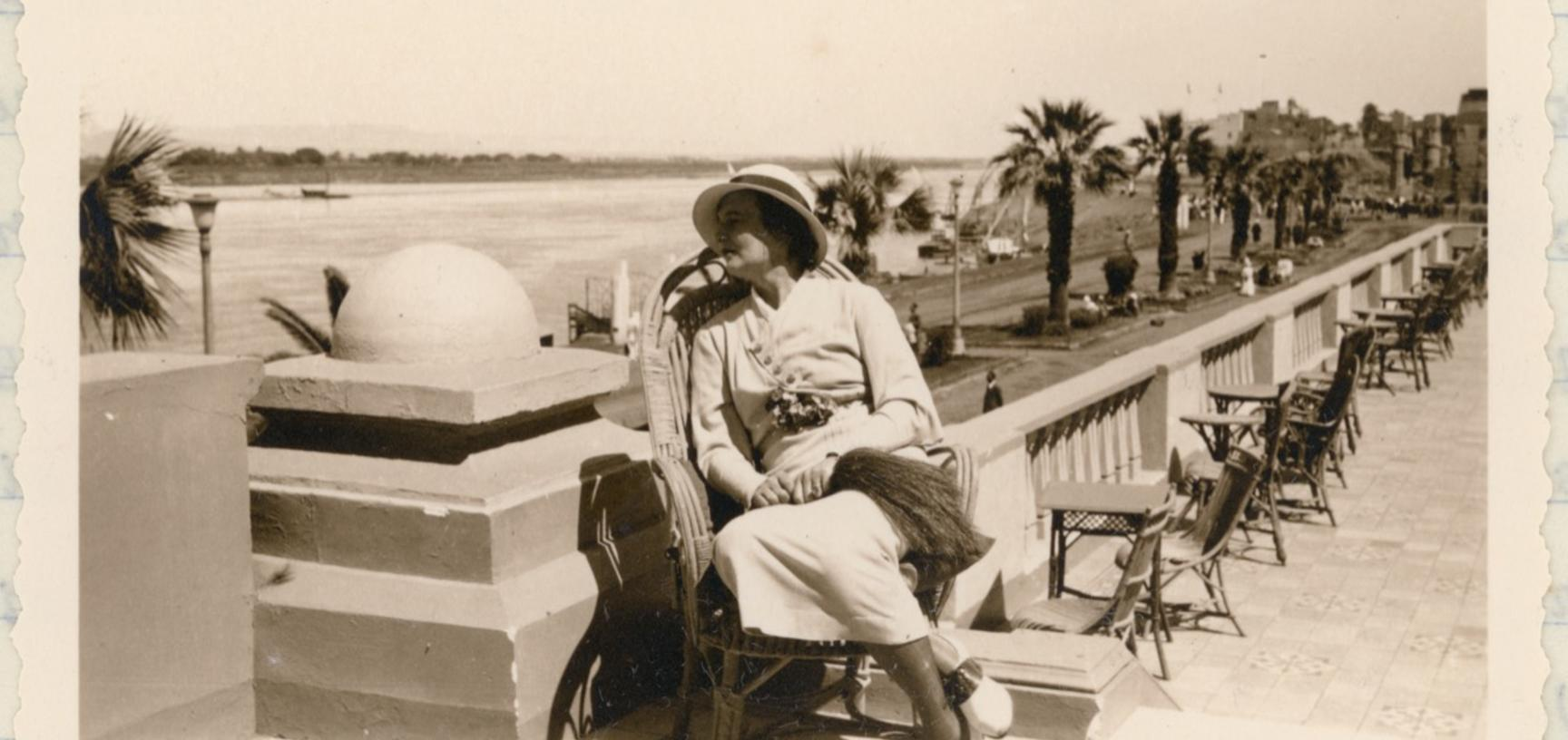 Portrait of Ellen Ettlinger, pictured sitting on a hotel terrace alongside the River Nile. Luxor, Egypt. Photographer unknown. 17 March 1935.