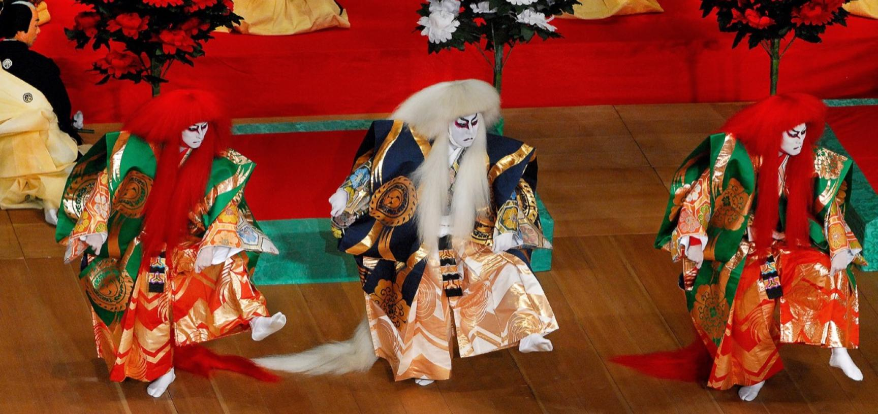 Scene from the play Renjishi, in which a pair of comic actors wearing lion costumes, Sakon and his son Ukon, are transformed into the living spirits of those lions. Here the celebrated actor Nakamura Kanzaburō XVIII, playing the white-maned father lion, i