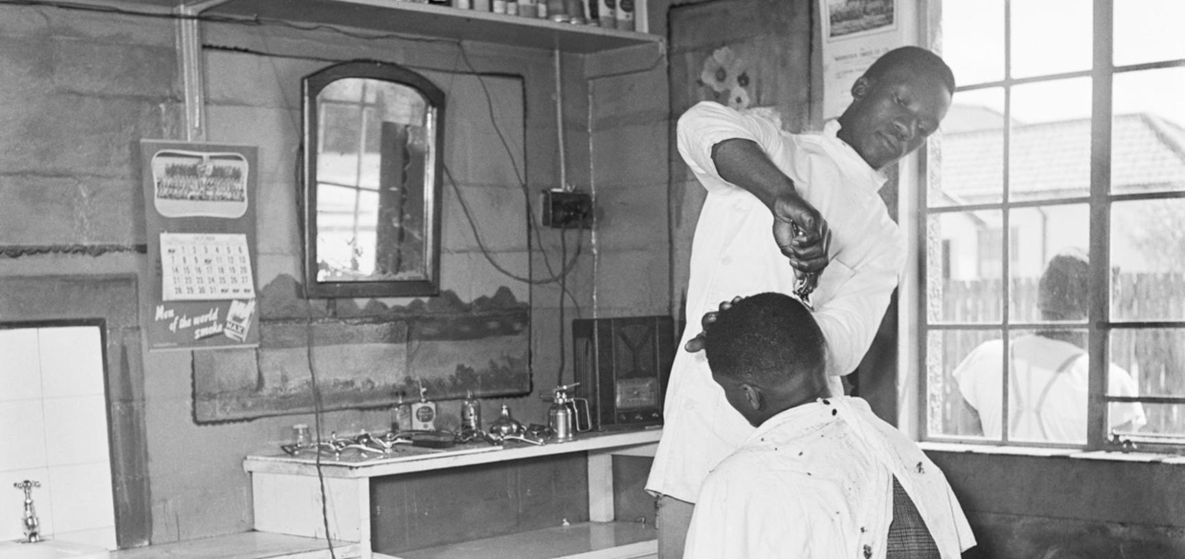 Barber shop. Langa, Cape Town, South Africa. Photograph by Bryan Heseltine. Circa 1949–1952. (Copyright Bryan Heseltine)