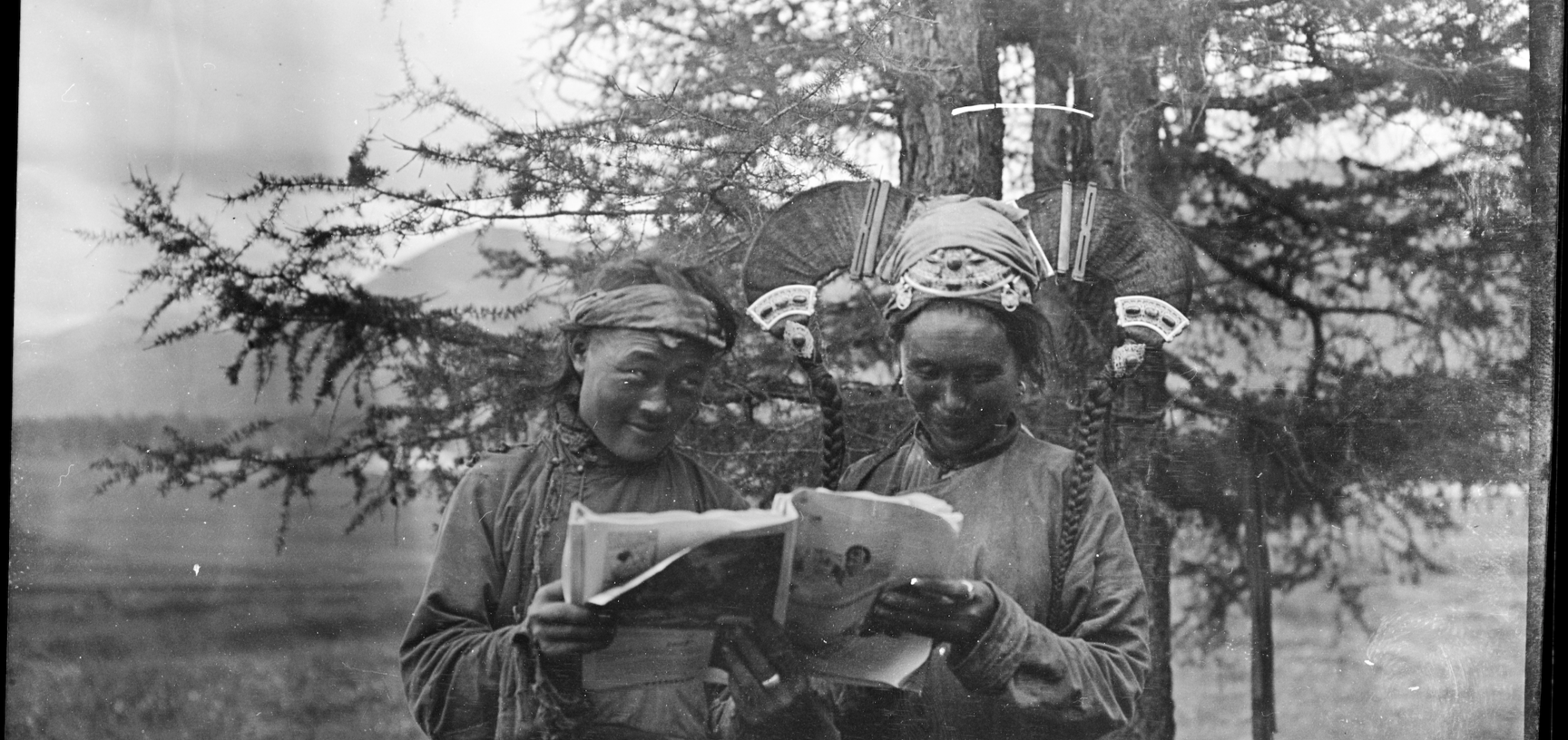 Two Mongols reading Life magazine, 1919.