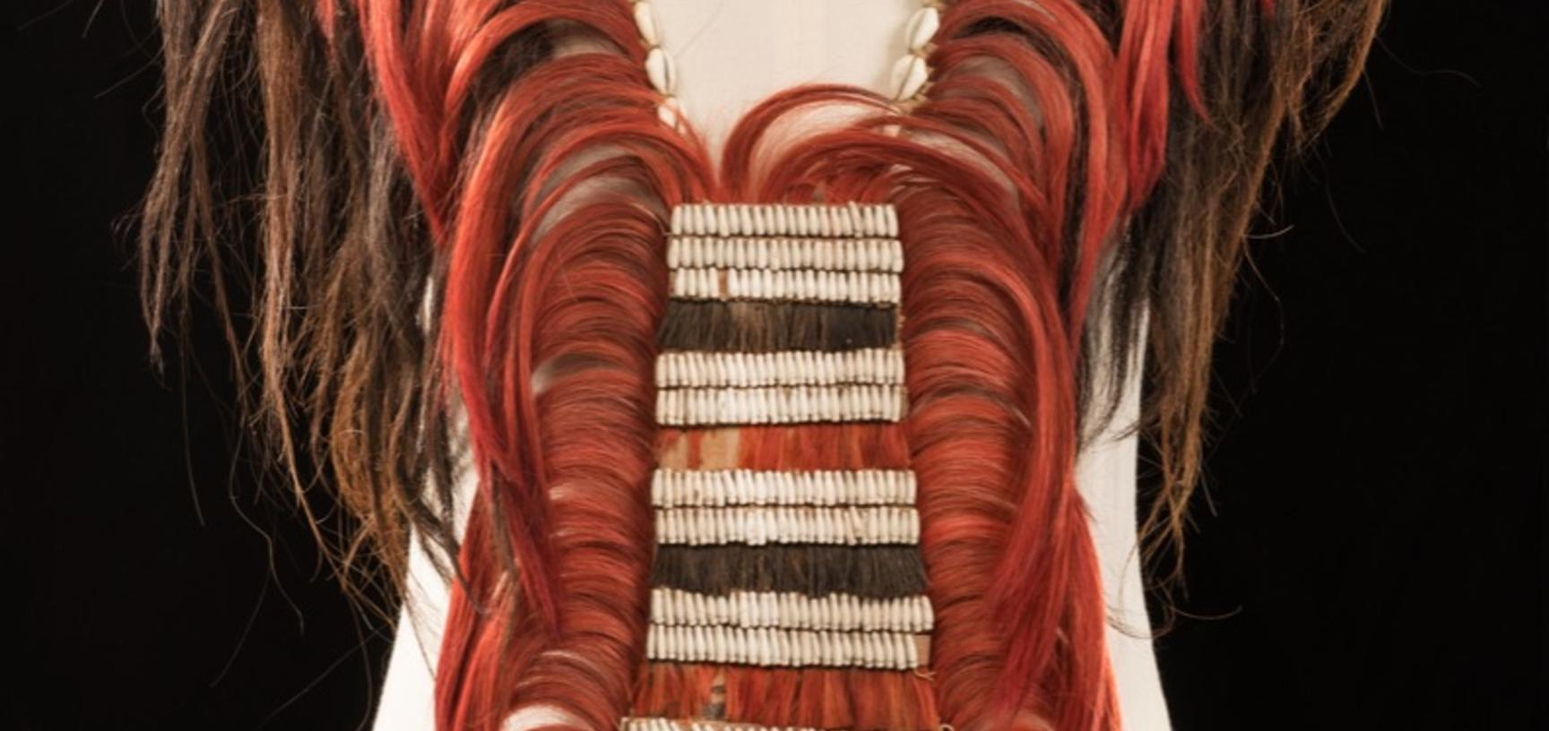 Angami Naga neck and breast ornament: 'Ornament for neck & breast of hair[,] cowries & coix seeds: a sign of conspicuous bravery' (handwritten caption on catalogue index card). Collected by Robert Gosset Woodthorpe; donated to the Pitt Rivers Museum by Ed