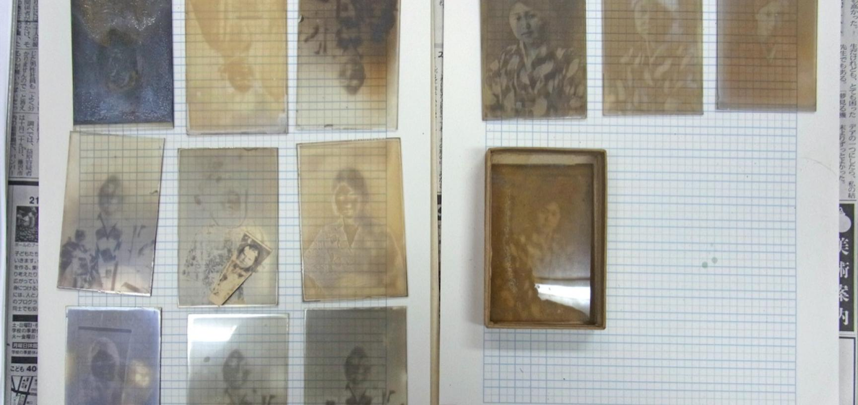 Early twentieth-century glass plates drying in the RD3 Project's workspace. (Copyright RD3 Project/Rikuzentakata City Museum)