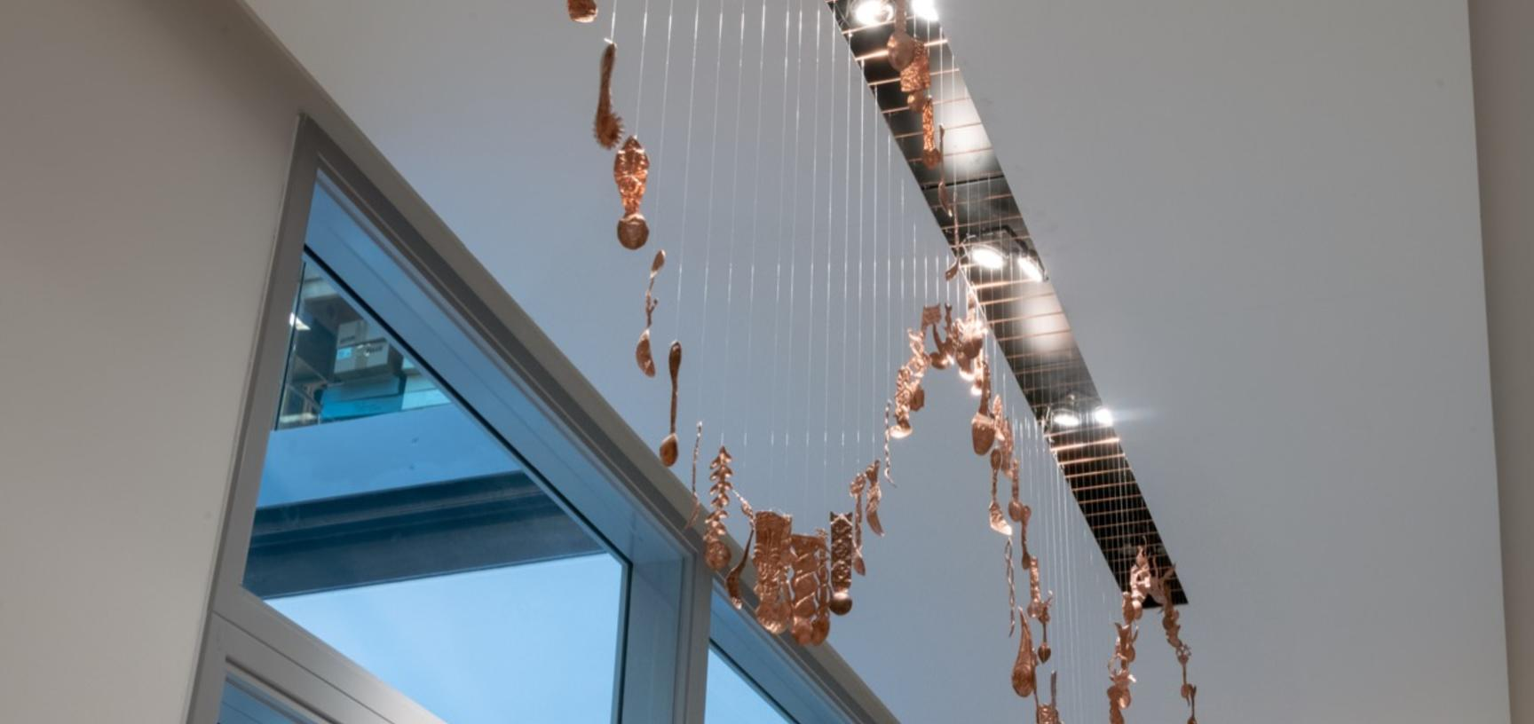 Teaspoons and Trinkets decoration hanging from the ceiling.