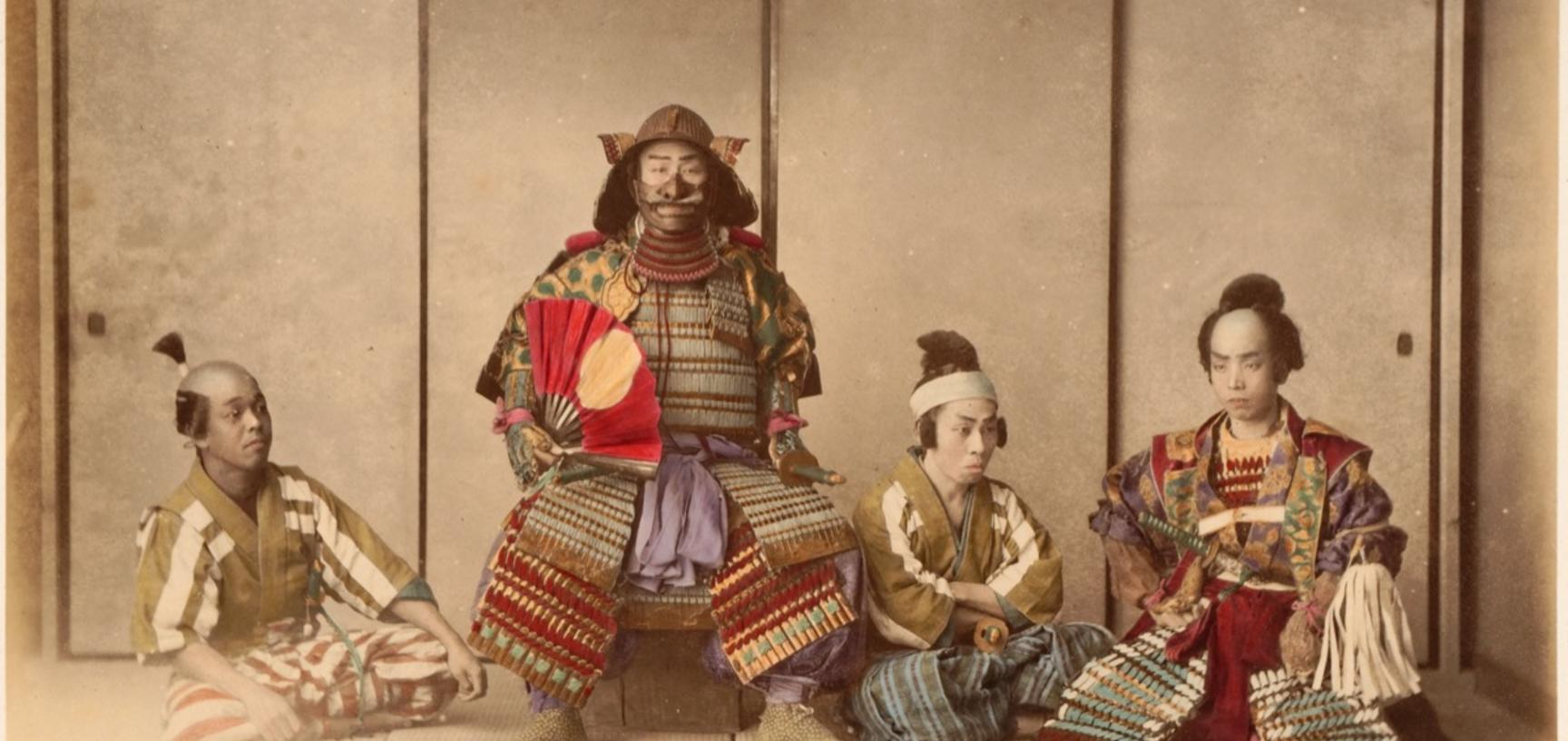 Studio portrait of actors wearing the traditional armour of the samurai, captioned (in English) as illustrating a 'general and staff'. Photograph by the Adolfo Farsari studio ('A. Farsari & Co.'). Yokohama, Japan. Circa late 1880s. (Copyright Pitt Rivers