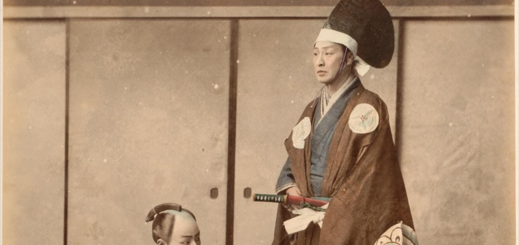 Studio portrait of a man dressed as a daimyō, one of the great landowning lords of feudal Japan and a vassal of the Shogun. Photograph by the Adolfo Farsari studio ('A. Farsari & Co.'). Yokohama, Japan. Circa late 1880s. (Copyright Pitt Rivers Museum, Uni