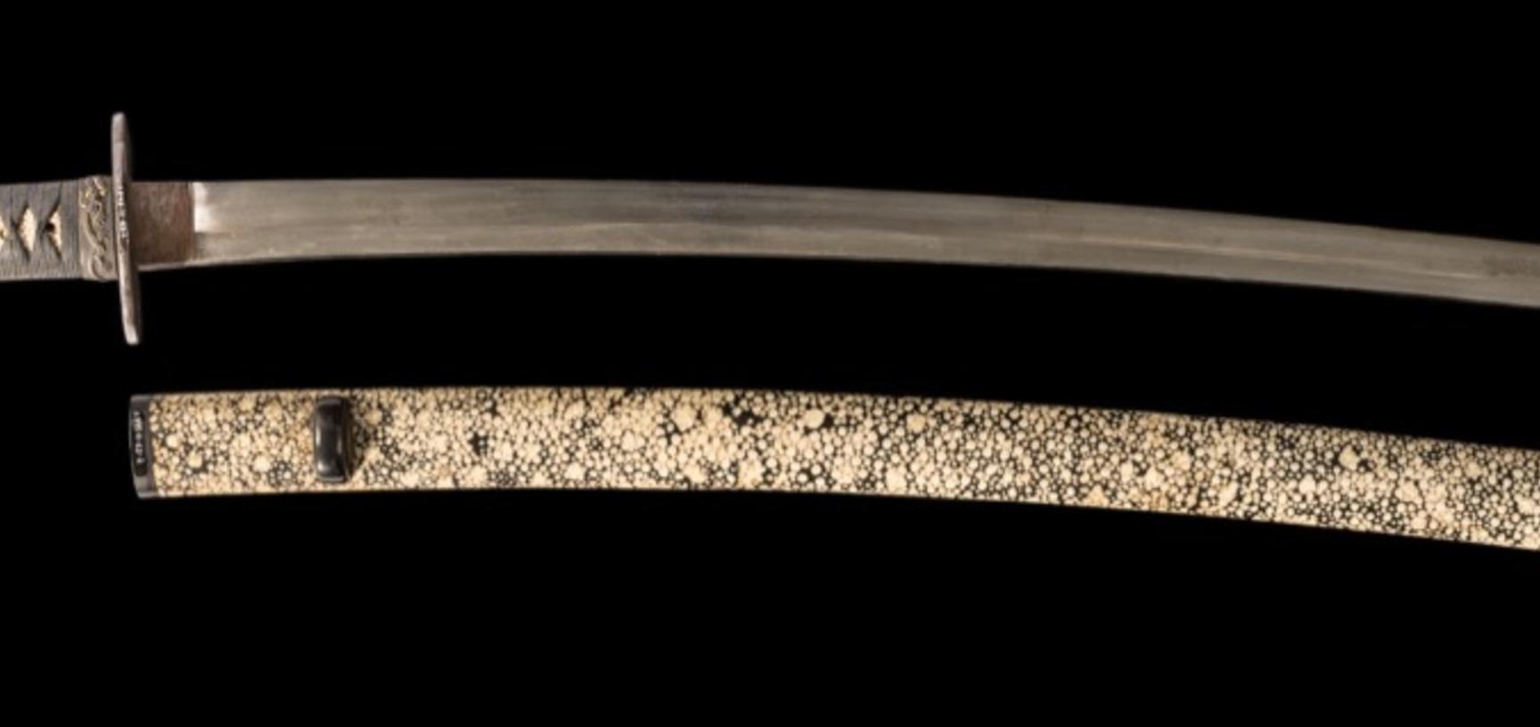 This katana, or long sword, nearly a metre in length, has at some point in its history been shortened (by removing part of the tang, including some of the signature). Certain features of the blade, however, suggest that it was made by a (lesser) smith of