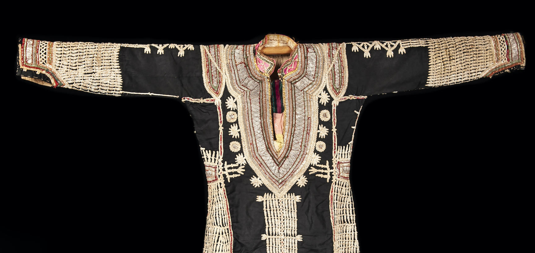 A dark long sleeve dress decorated with gold embroidery.