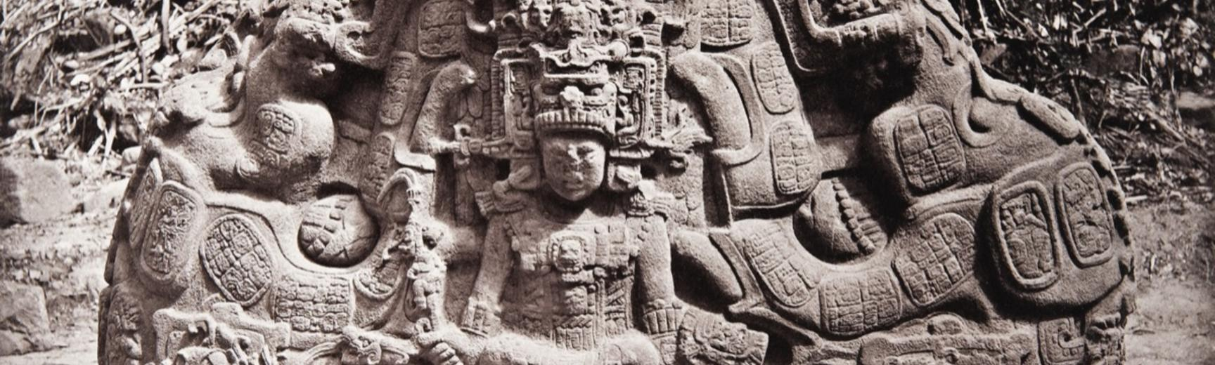 Zoomorph P (also known as Monument 16), north face, dated AD 795. This massive stone carving, now understood to represent the Cosmic Monster of Maya mythology, was known by Alfred Maudslay as the 'Great Turtle', and can be seen marked on his map of the Qu