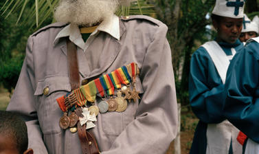 A veteran of the Imperial Guard pays his final respects. Addis Ababa, Ethiopia. Photograph by Peter Marlow. 2000.