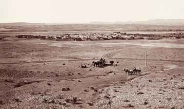 View of Santo Domingo Pueblo (present-day Kewa Pueblo), located about thirty miles south of Santa Fe, with a railway line and telegraph poles visible in the foreground.