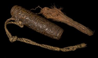 Intricately carved flute.