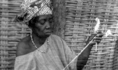 Woman spinning in Guinea-Bissau. (Copyright Ethnographic Museum of Guinea-Bissau)