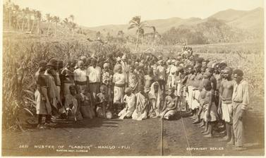 "'Muster of ""labour""', a group portrait of agricultural workers employed in the sugar cane plantations at Mango on the island of Viti Levu. Photograph by Alfred Burton for the Burton Brothers studio (Dunedin). Mango, Viti Levu, Fiji. 16 July 1884. (Copyrig"