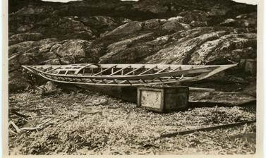One of the various stages in the construction of a kayak by Inuit, here showing its underlying wooden frame. Photograph by Henry Iliffe Cozens. Greenland. 1930–1931.