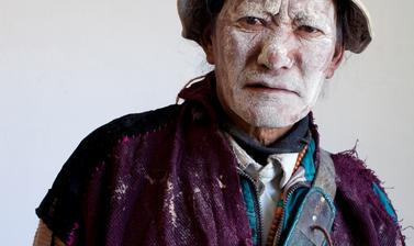 Gatuk Namgyal dressed as the elephant keeper from the play 'Drimed Kunden'. Photograph by Patrick Sutherland. Sangnam, Spiti, Himachal Pradesh, India.