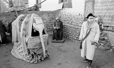 A performance of 'The Elephant', a scene from the story of Prince Drimed Kunden, one of the most popular plays in the Buchen repertoire. Photograph by Patrick Sutherland. Lara, Spiti, Himachal Pradesh, India. 2004.