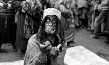 Nyima Dorje performing as the deaf mother of the 'crazy saint' Drukpa Kunley. Buchen plays are a local and peripheral form of the Tibetan Opera. Photograph by Patrick Sutherland. Mane, Spiti, Himachal Pradesh, India. 2007.
