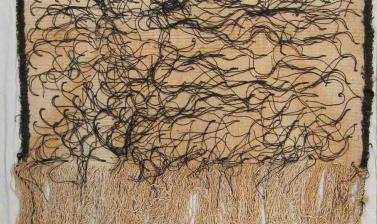 Partly-made dress cloak (korowai), circa 1910. Māori Te Arawa people. Whakarewarewa village, near Rotorua, North Island, New Zealand. The body of the cloak (kaupapa) is woven using New Zealand flax fibre (muka) for the warp (whenu) and cotton cord for the