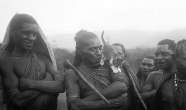 Warriors with Sally the cat. Anga people. Manki village, Morobe Province, Papua New Guinea. 'Some of the toughest old warriors would spend hours trailing bits of string for her to play with. I can send you, if you are interested, a photograph of a group o