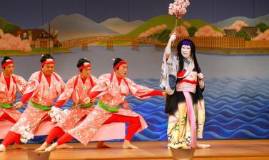 Scene from the play Sumidagawa Gonichi no Omokage, also known as Hokaibō, in a production by contemporary kabuki company Heisei Nakamura-za. This scene still, with its brightly painted set decoration and the colourful costumes of the actors, gives some se