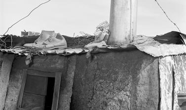 Shoes drying on rooftop. Windermere, Cape Town, South Africa. Photograph by Bryan Heseltine. Circa 1949–1952. (Copyright Bryan Heseltine)