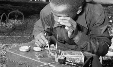 Watch repairs. Windermere, Cape Town, South Africa. Photograph by Bryan Heseltine. Circa 1949–1952. (Copyright Bryan Heseltine)