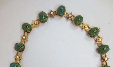 Short gold necklace set with alternating green beetle wings and pearl