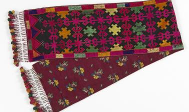 Man's scarf. Sherakot, Kohistan, Pakistan. This scarf is embroidered in coloured silks in the style typical of Swat Kohistan.