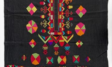 Embroidered cotton shift (incomplete). Bar Paro, Palas Valley, Kohistan, Pakistan. Instead of traditional silk, solar motifs and the protective power of the triangle are embroidered in cotton yarn.