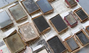 Fragile glass negatives, still in their original boxes, are laid out to dry. (Copyright RD3 Project/Rikuzentakata City Museum)