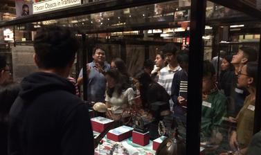 Thupten Kelsang discussing the display with teenage members of the UK's Tibetan community during a public engagement event, 'My Tibet Museum', held at the Pitt Rivers Museum in October 2018. (Copyright Pitt Rivers Museum, University of Oxford)