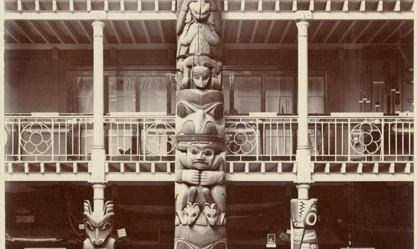 Interior view of the Pitt Rivers Museum, looking towards the east end of the Court, showing the Haida totem pole ('Star House Pole'). Photograph by Alfred Robinson. Oxford, England. 1901.